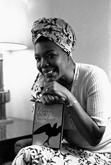 """A young Maya Angelou with a copy of I Know Why the Caged Bird Sings"". May 31, 2014. Dazed.com"